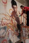 Hung Liu painting on mural